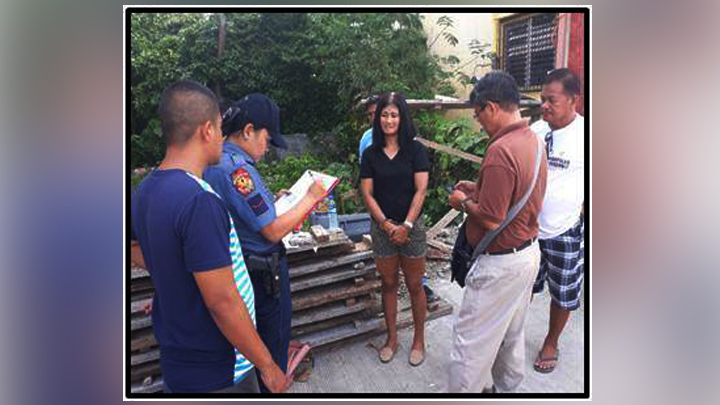 Suspected drug pusher and user Maria Lourdes Escueta being arrested by the authorities.