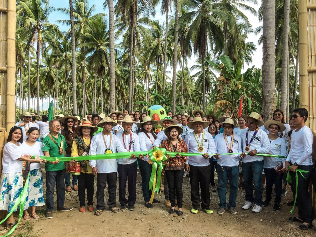 DOT MIMAROPA Regional Director Danilo Intong (fifth from left), Mayor Jean Feliciano (eight from left) and tourism officer Arlene Piramide (second from right) lead AgriWorld's ribbon cutting ceremony. Photo by Keith Anthony Fabro / Backpacking Palawan
