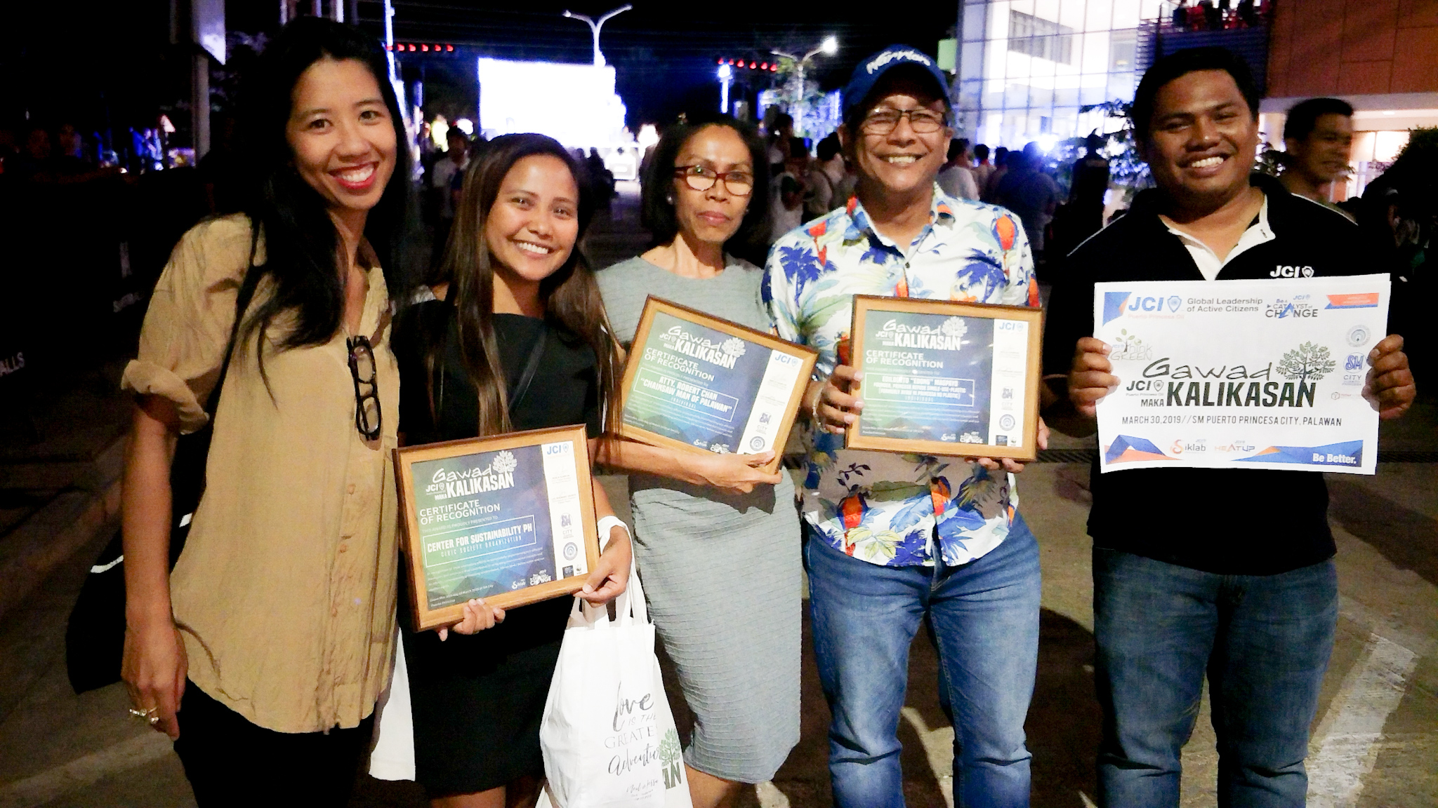 "From Left  to Right, Center for Sustainability PH, Inc (awardee for Gawad Makakalikasan, Civic Society Organization Category) Jessa Garibay and Karina Mae Reyes;  Atty Robert Chan ""Chainsaw Man of Palawan"" represented by Lorie Cagatulla, awardee for Gawad Makakalikasan Individual Category; Edong Magpayo ""Founder of Ayaw ni Princesa ng Single-Used Plastic"" awardee for Individual Category and 2019 President of JCI Puerto Princesa Oil Rexlin Azarcon. Photo from Gilbert Ramoya / JCI Puerto Princesa Oil."