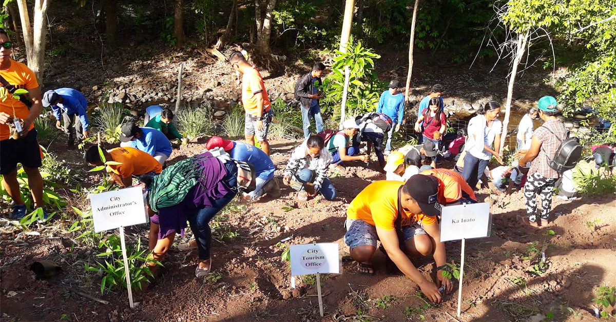 Tree planting activity during the Earth Day at Yamang Bukid Farm - Palawan. Participats from different Agencies, Individual and offices. Photo by Peter Policarpio / Palawan Daily News