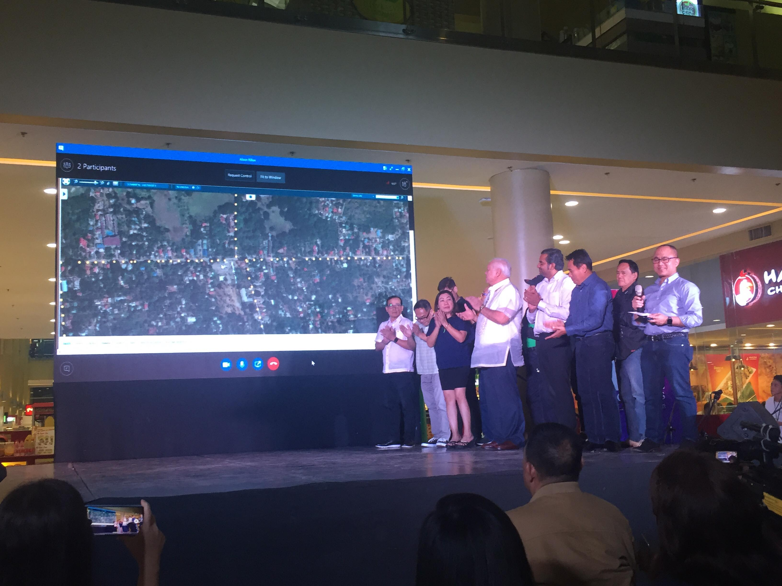 Puerto Princesa City Mayor Lucilo Bayron together with other city officials lead the inauguration of the country's first smart city-enabled lighting system, July 1, at Robinson's Place, Puerto Princesa City