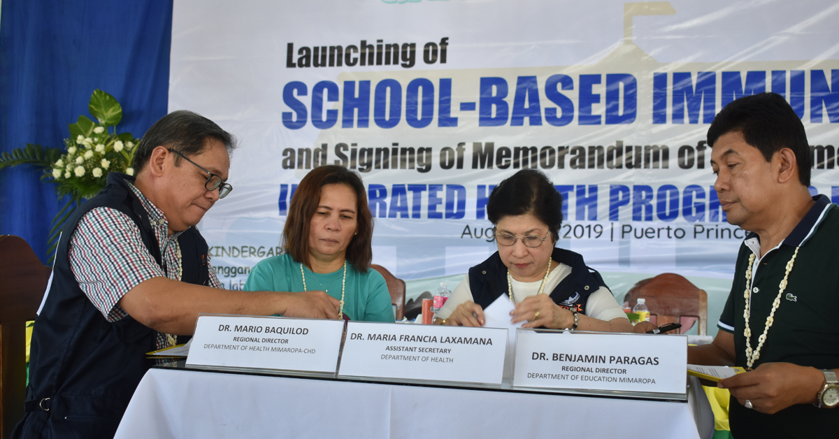 During the MOA signing at Pilot Elementary School. Photo by Eugen Murray
