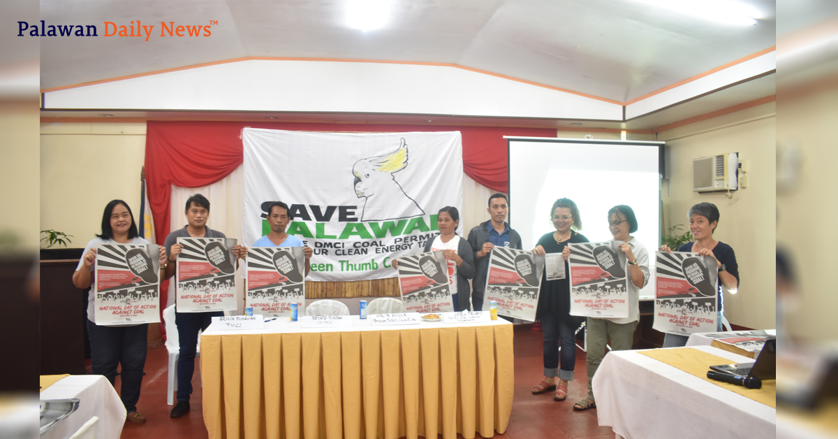 ELAC members hold up anti-coal banners during the press conference. Photo by Eugene Murray / Palawan Daily News