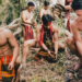 Members of Tawid Cultural Performing Group, popularly known as the Igorot Hunks, plant tree seedlings at the bank of a stream at Yamang Bukid Farm-Palawan in Brgy. Bacungan, Puerto Princesa City, Sept. 29. Photos by Aris Leoven