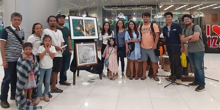 "Members of the Art on the Move during the opening of the ""Ukit, Kulay, at Tinta"" art exhibit at SM City Puerto Princesa. Photo by Wendi Garcia"