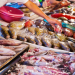 A fish vendor prepares to sell a variety of seafood. (PDN file photo).