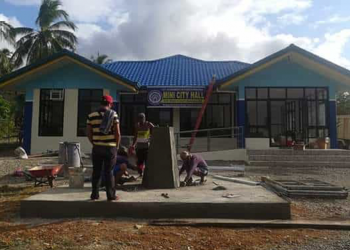 Napsan Mini City Hall personnel finishes the facility's flag pole for the first flag raising ceremony with Mayor Lucilo Bayron on Monday, January 20. Photo courtesy of Richard Ferrer, executive assistant to the deputy mayor of Napsan Mini City Hall